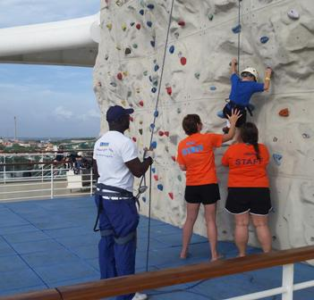 Staff help kid Rock Wall